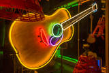 USA, Texas, Austin. Neon Guitar at Blackmail shop. Photographic Print by Randa Bishop