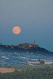 Italy, Tuscany, Pienza, Full Harvest Moon over Pienza. Photographic Print by Terry Eggers