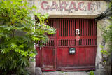 Old Garage door near Rue de Faubourg Saint-Antoine, Paris, France. Photographic Print by Brian Jannsen