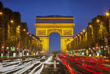 Twilight along Champs Elysee with Arc de Triomphe, Paris, France. Photographic Print by Brian Jannsen