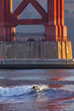 Surfing under the Golden Gate Bridge, San Francisco, California, USA Photographic Print by Chuck Haney