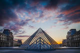 Courtyard of Musee du Louvre at sunset, Paris, France. Photographic Print by Brian Jannsen