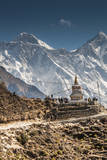 Trail through Khumbu Valley with Mt. Everest in background. Photographic Print by Lee Klopfer