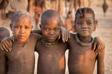 Three young Himba buddies, Opuwo, Namibia. Photographic Print by Wendy Kaveney