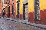 Mexico, San Miguel de Allende. Elderly man walks up sidewalk. Photographic Print by Don Paulson