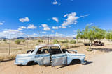 Abandoned car in Solitaire Village, Khomas Region, Namibia. Photographic Print by Nico Tondini