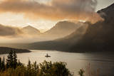 USA, Montana, Glacier NP. Sunrise pierces clouds over St. Mary Lake. Photographic Print by Don Grall