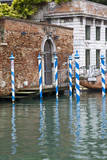Italy, Venice, Gondola mooring posts in the canals of Venice. Photographic Print by Terry Eggers