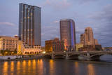 Skyline at dusk, on the Grand River, Grand Rapids, Michigan. USA. Photographic Print by Randa Bishop