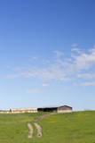 USA, Montana, Fergus County, Hay bales and barn. Photographic Print by Jamie & Judy Wild