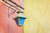 Mexico, San Miguel de Allende. Traditional street lamp on wall. Photographic Print by Don Paulson