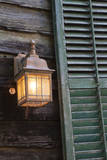 USA, Florida, St. Augustine, Shutter and lantern on old house. Photographic Print by Joanne Wells
