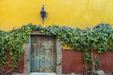 Mexico, San Miguel de Allende. Doorway to colorful building. Photographic Print by Don Paulson