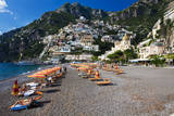 Italy, Positano, Sunbathers at the beach in the Town of Positano. Photographic Print by Terry Eggers