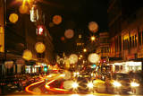 Traffic and rain at night, Lower Stuart St Dunedin, Otago, New Zealand Photographic Print by David Wall