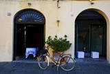 Italy, Lucca, Street Scene with bicycles ready to go. Photographic Print by Terry Eggers