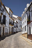 Spain, Andalusia, Malaga Province, Ronda. Street scene in Ronda. Photographic Print by Julie Eggers