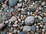 USA, Michigan. Polished pebbles on the shore of Lake Superior. Photographic Print by Anna Miller