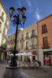 An outdoor cafe in a small square in the town of Avila, Spain. Photographic Print by Julie Eggers