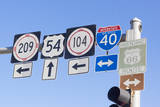 USA, New Mexico, Tucumcari. Road signs. Photographic Print by Wendy Kaveney