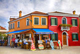 Italy, Burano, Colorful Houses and Restaurant of Burano. Photographic Print by Terry Eggers