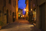 Main Street of Pienza with evening Blue Light and Street Lights. Photographic Print by Terry Eggers