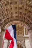 Giant flag flies in the middle of Arc de Triomphe, Paris, France Photographic Print by Brian Jannsen