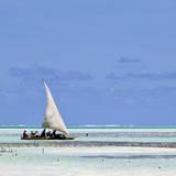 Sailboat along Zanzibar's Eastern Shore, Jambiani, Zanzibar, Tanzania. Photographic Print by Charles Cecil