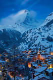 Twilight over the Matterhorn and village of Zermatt, Switzerland Photographic Print by Brian Jannsen