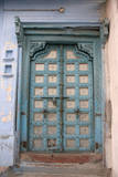 Blue-painted door, Jojawar, Rajasthan, India. Photographic Print by Inger Hogstrom