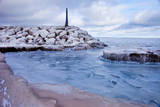 Ice flow around a stone breakwater on Lake Erie in Madison, Ohio, USA Photographic Print by Brian Jannsen