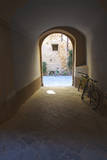 Walk way with Bicycles in the Tunnel. Photographic Print by Terry Eggers