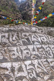 Mani Stones and prayer flags. Photographic Print by Lee Klopfer
