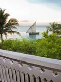 Stone Town, Zanzibar, Tanzania. A dhow seen from a Serena Inn balcony. Photographic Print by Charles Cecil
