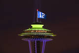 Space Needle with Seahawk colors and 12th man flag. Washington, USA Photographic Print by Jamie & Judy Wild