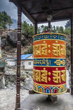 Prayer wheel along a trail, Phakding, Nepal. Photographic Print by Lee Klopfer