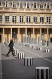 A man walks across the courtyard of Palais Royal, Paris, France Photographic Print by Brian Jannsen