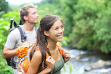 People Hiking - Happy Hiker Couple Trekking as Part of Healthy Lifestyle Outdoors Activity Photographic Print by  Maridav
