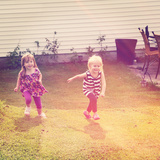 Little Girls Running in Grass Photo by  melking