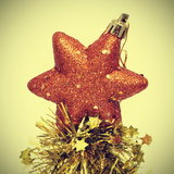 Star-Shaped Christmas Ornament and Golden Tinsel with a Retro Effect Photographic Print by  nito