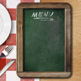 Menu Blackboard Lying on Table with Plate, Knife and Fork Photographic Print by  Andrey_Kuzmin