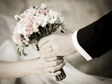 Groom Handing Wedding Bouquet to Bride Photographic Print by  melis