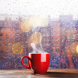 Steaming Cup of Coffee over a Cityscape Background Reprodukcja zdjęcia autor George D.
