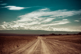 Empty Rural Road Going Through Prairie under Cloudy Sky in Charyn Canyon Photographic Print by Im Perfect Lazybones