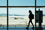 Silhouette of Young Woman Walking at Airport Photographic Print by Nomad Soul