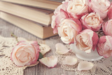 Pink Roses and Old Books on Wooden Desk Photographic Print by  egal