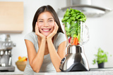 Green Smoothie Woman Making Vegetable Smoothies with Blender Photographic Print by  Maridav