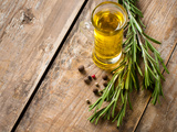 Cooking Oil and Fresh Rosemary Photographic Print by  manera