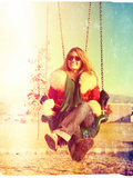 A Pretty Woman Sitting in a Swing Photographic Print by  graphicphoto