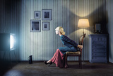 Young Woman Sitting on a Chair in Vintage Interior and Watching Retro TV Photographic Print by  viczast